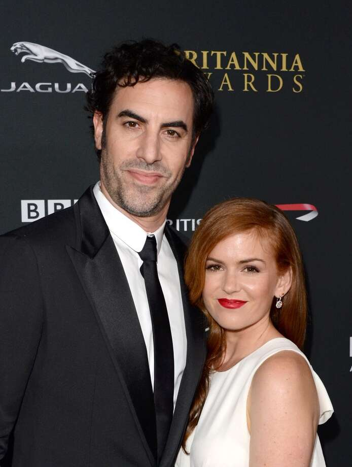 Actors Sacha Baron Cohen (L) and Isla Fisher attend the 2013 BAFTA LA Jaguar Britannia Awards presented by BBC America at The Beverly Hilton Hotel on November 9, 2013 in Beverly Hills, California. Photo: Jason Merritt, Getty Images