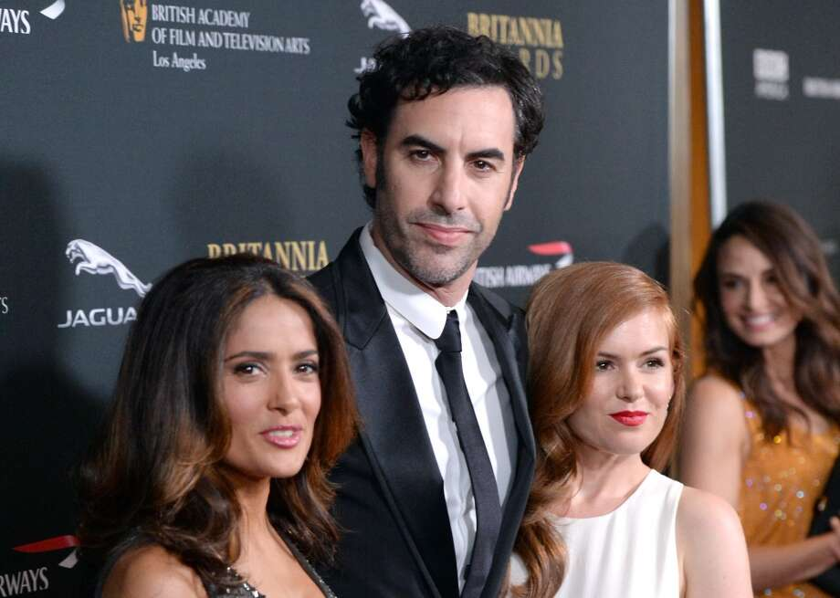 (L-R) Actress Salma Hayek, actor Sacha Baron Cohen, and actress Isla Fisher attend the 2013 BAFTA LA Jaguar Britannia Awards presented by BBC America at The Beverly Hilton Hotel on November 9, 2013 in Beverly Hills, California. Photo: Jason Merritt, Getty Images