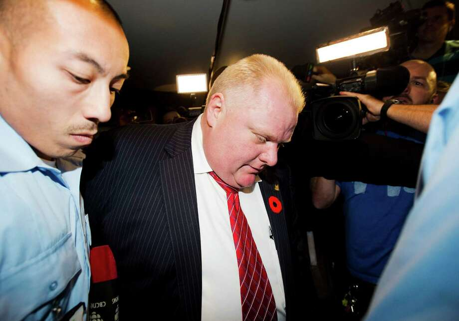 "Toronto Mayor Rob Ford arrives at his office, surrounded by the media in Toronto on Friday, Nov. 8, 2013.  Ford's lawyer says the mayor is considering his options, including going into rehab. Dennis Morris tells The Associated Press that it is up to Ford to say he what he plans to do himself because ""when you go left, he goes right."" A new video surfaced showing Ford spewing profanities and threatening to murder someone, was a defining day for the mayor. Ford apologized, saying he was extremely inebriated and embarrassed, but refused to identify the target of, or reason for, his rage. Photo: Nathan Denette, AP / The Canadian Press"