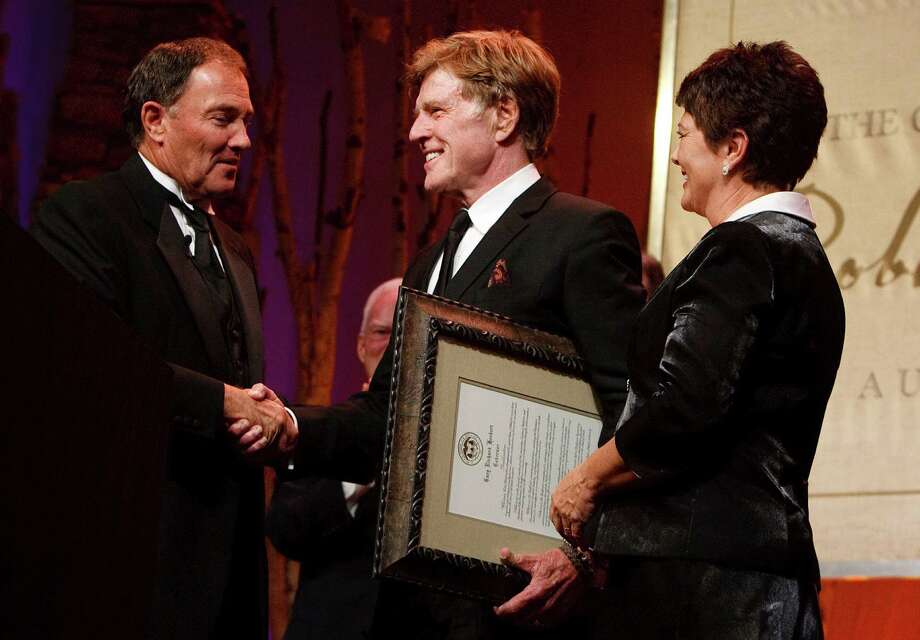 Gov. Gary Herbert and his wife Jeanette present Robert Redford with the declaration that Nov. 9, 2013 is Robert Redford Day. For all his contributions to the state of Utah, Robert Redford was recognized and honored by Governor Gary Herbert at a gala in his honor at the Grand America Hotel, Saturday, Nov. 9, 2013. Photo: Leah Hogsten, AP / Leah Hogsten2013