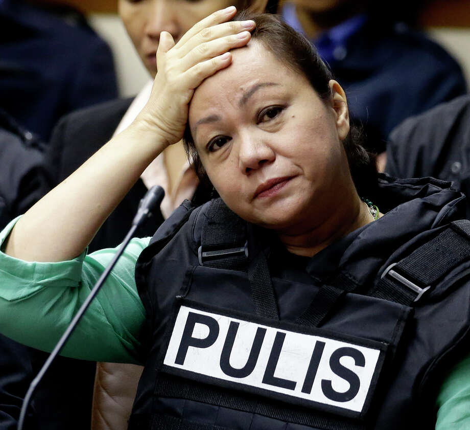"Janet Lim Napoles, a wealthy businesswoman who allegedly stole huge amounts of government development funds, derisively called pork-barrel funds, in conspiracy with powerful lawmakers, puts her hand on her forehead as she testifies before the Senate Blue Ribbon Committee Thursday Nov. 7, 2013 at suburban Pasay city, south of Manila, Philippines. The ""Pork Barrel"" scandal was exposed following the surrender of Napoles after the Government put up a bounty for her capture. Napoles arrived at the Senate wearing a bullet-proof vest. Photo: Bullit Marquez, AP / AP"