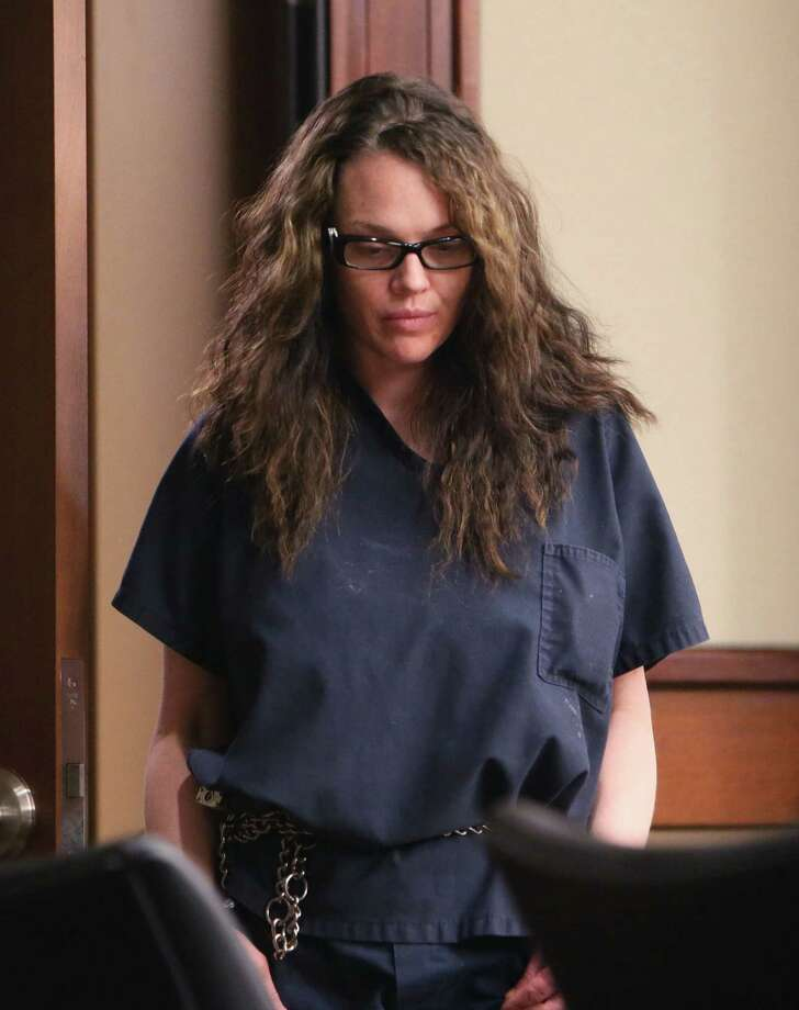 "In this Aug. 1, 2013 file photo, Anna Benson enters court in Marietta, Ga. The estranged wife of a former major league pitcher who also was featured on the VH-1 show ""Baseball Wives"" has pleaded guilty to aggravated assault and weapons charges.  Cobb County District Attorney's spokeswoman Kim Isaza said Tuesday, Nov. 5, 2013, that 37-year-old Anna Benson pleaded guilty to being armed with a gun when she went to Kris Benson's suburban Atlanta home July 7 and demanded $30,000 from him. Photo: Bob Andres, AP / AJC"