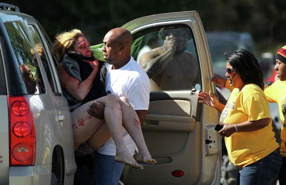 Marcus Arceneaux carries his wounded niece, Bethany Arceneaux, left, to a vehicle after she was rescued from a vacant house on Anderson Road on Friday, Nov. 8, 2013, in Duson, La. The Associated Press: Authorities had been searching for Scott Thomas, 29, of Leonville, since Wednesday when he arrived at a daycare center and confronted Bethany Arceneaux, 29.  Thomas allegedly forced Arceneaux into his vehicle and drove away. Her 2-year-old child was left inside her car at the daycare.  Lafayette Parish Sheriff's Office spokesman Kip Judice confirmed Friday that Thomas was dead. Judice told The Advertiser Thomas succumbed to injuries sustained during a confrontation with Arceneaux's relatives.  Judice said friends and family were searching for Arceneaux Friday and entered a vacant house where they believed they heard someone screaming. Thomas, who was armed with a knife, allegedly began to injure Arceneaux and one of Arceneaux's family members shot Thomas to stop him. Photo: Leslie Westbrook, The Advertiser, AP / The Lafayette Daily Advertiser