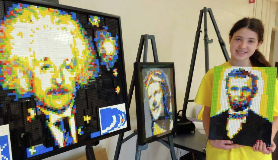 Julia Lawlor, 13, of Fairfield, demonstrated her LEGO mosaic mastery, with portraits of famous people made from the blocks, such as Einstein and Lincoln, which she displayed Saturday at the Block Party benefiting the b-Cause Foundation. Photo: Meg Barone / Fairfield Citizen contributed