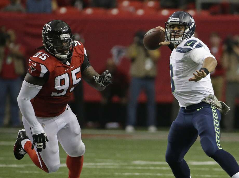 Seattle Seahawks quarterback Russell Wilson (3) works as Atlanta Falcons defensive tackle Jonathan Babineaux (95) pursues during the first half of an NFL football game, Sunday, Nov. 10, 2013, in Atlanta. (AP Photo/David Goldman) Photo: AP