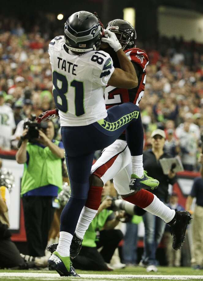 Seattle Seahawks wide receiver Golden Tate (81) catches a ball as Atlanta Falcons cornerback Asante Samuel (22) defends during the first half of an NFL football game, Sunday, Nov. 10, 2013, in Atlanta. Tate landed out of bounds on the catch. (AP Photo/David Goldman) Photo: AP