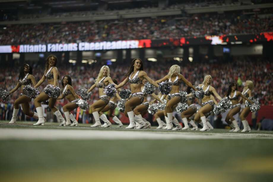 Atlanta Falcons cheerleaders wearing Digital Camouflage  uniforms in Salute to Service perform during the first half of an NFL football game against the Seattle Seahawks, Sunday, Nov. 10, 2013, in Atlanta. (AP Photo/David Goldman) Photo: AP
