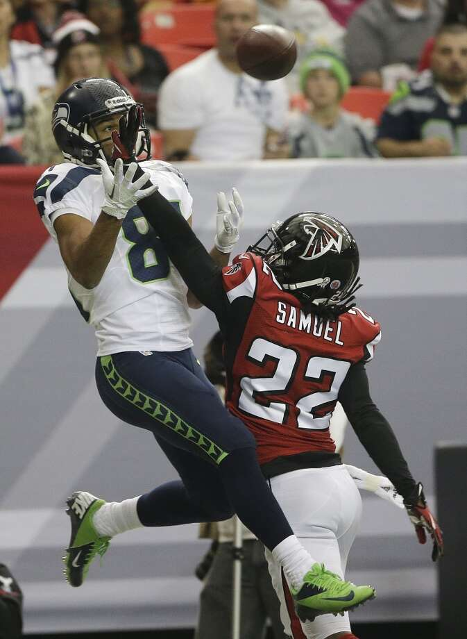 Seattle Seahawks wide receiver Golden Tate (81) waits for a ball as Atlanta Falcons cornerback Asante Samuel (22) defends during the first half of an NFL football game, Sunday, Nov. 10, 2013, in Atlanta. The play was ruled incomplete. (AP Photo/John Bazemore) Photo: AP