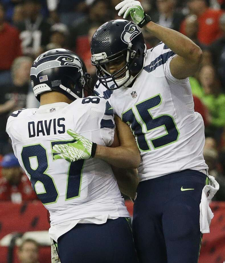 Seattle Seahawks wide receiver Jermaine Kearse (15) celebrates his touchdown with Seattle Seahawks tight end Kellen Davis (87) against the Atlanta Falcons during the first half of an NFL football game, Sunday, Nov. 10, 2013, in Atlanta. (AP Photo/David Goldman) Photo: AP