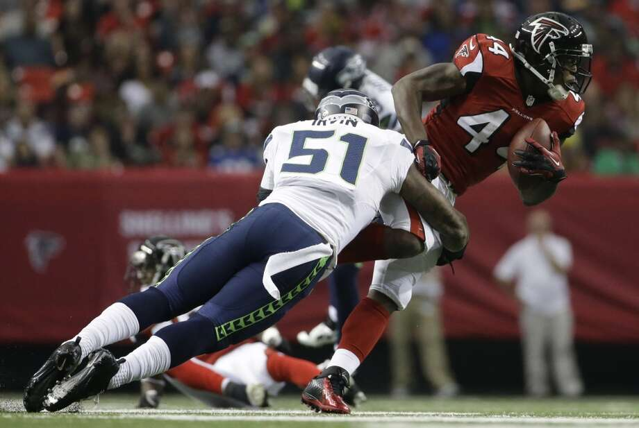 Atlanta Falcons fullback Jason Snelling (44) runs against Seattle Seahawks outside linebacker Bruce Irvin (51) during the first half of an NFL football game, Sunday, Nov. 10, 2013, in Atlanta. (AP Photo/David Goldman) Photo: AP