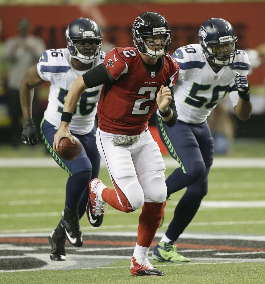 Atlanta Falcons quarterback Matt Ryan (2) runs out of the pocket during the first half of an NFL football game against the Seattle Seahawks, Sunday, Nov. 10, 2013, in Atlanta. (AP Photo/John Bazemore) Photo: AP