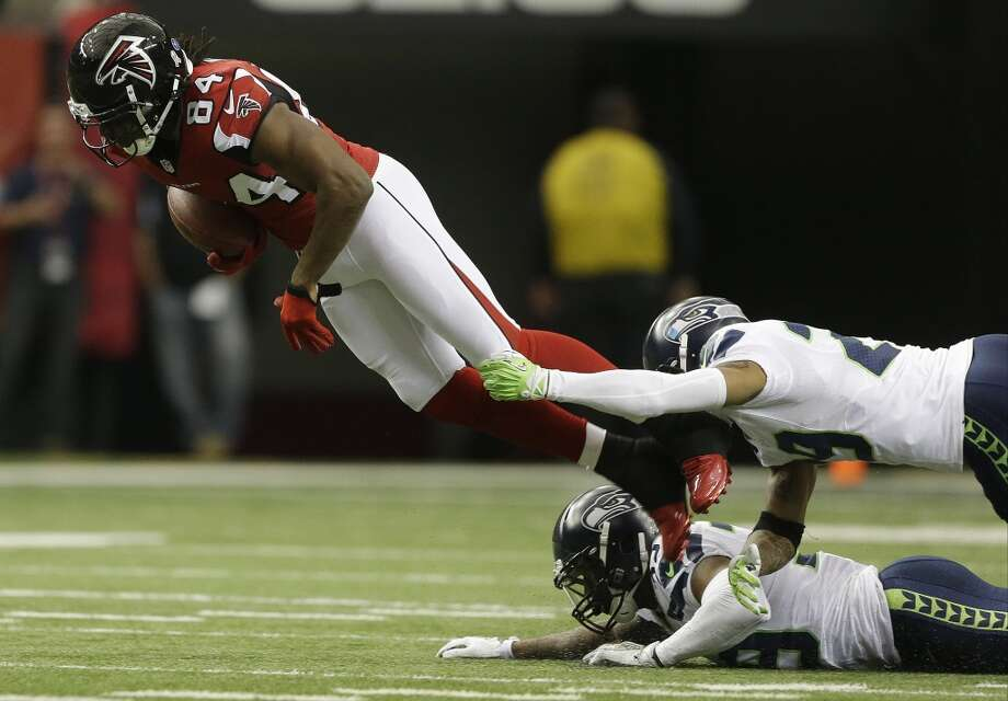 Atlanta Falcons wide receiver Roddy White (84) moves the ball against Seattle Seahawks free safety Earl Thomas (29) and Seattle Seahawks cornerback Brandon Browner, bottom, during the first half of an NFL football game, Sunday, Nov. 10, 2013, in Atlanta. (AP Photo/John Bazemore) Photo: AP
