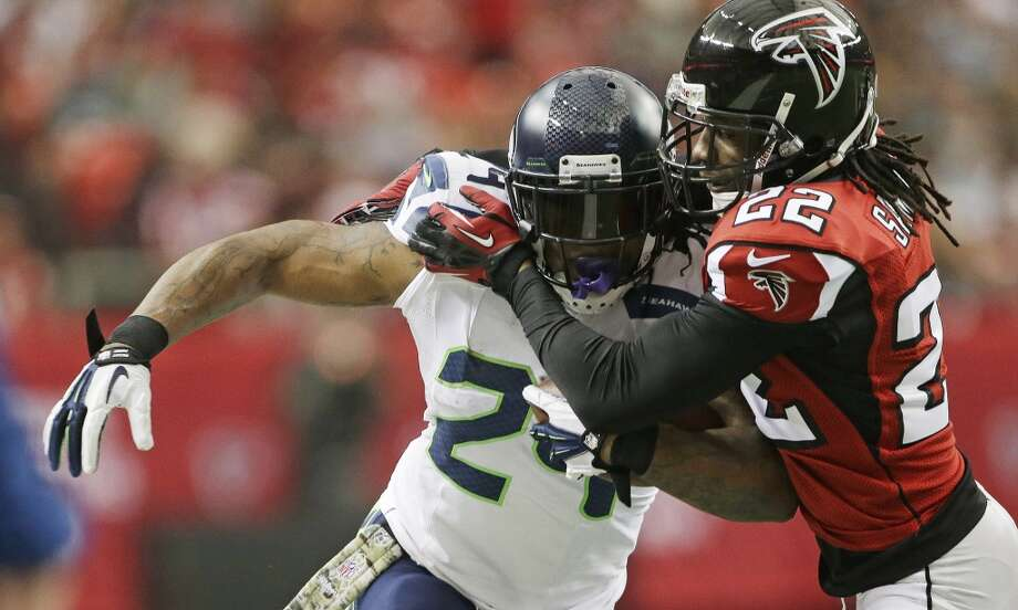 Seattle Seahawks running back Marshawn Lynch (24) runs into Atlanta Falcons cornerback Asante Samuel (22) during the first half of an NFL football game, Sunday, Nov. 10, 2013, in Atlanta. (AP Photo/John Bazemore) Photo: ASSOCIATED PRESS