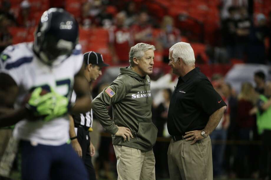 Seattle Seahawks head coach Pete Carroll, left, and Atlanta Falcons head coach Mike Smith speak before during the first half of an NFL football game, Sunday, Nov. 10, 2013, in Atlanta. (AP Photo/David Goldman) Photo: AP