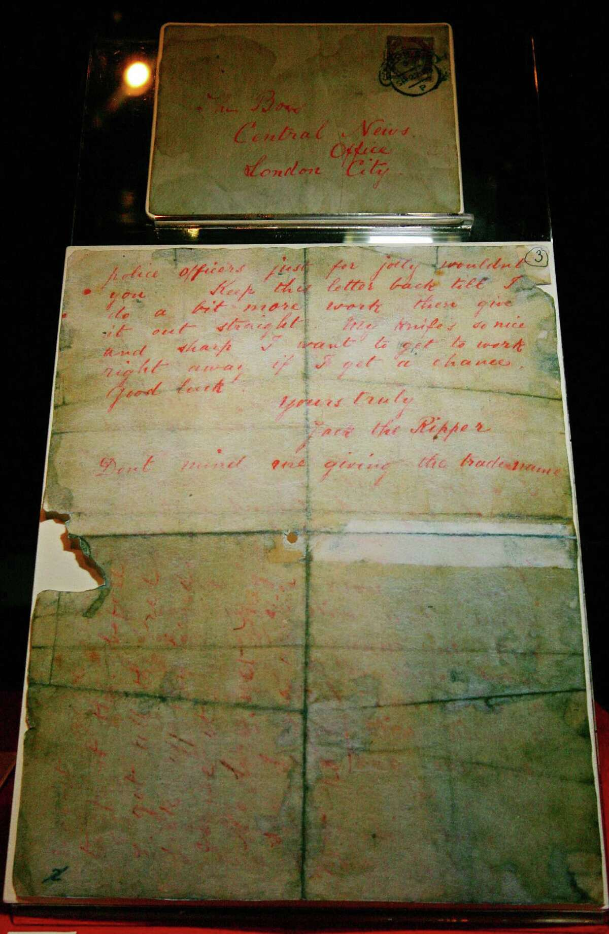 A letter allegedly written by Jack the Ripper and sent to a London news agency on Spetember 25, 1888 is displayed at a press preview of the 'Jack the Ripper and the East End' exhibition at Museum in Docklands, in London, on May 14, 2008.