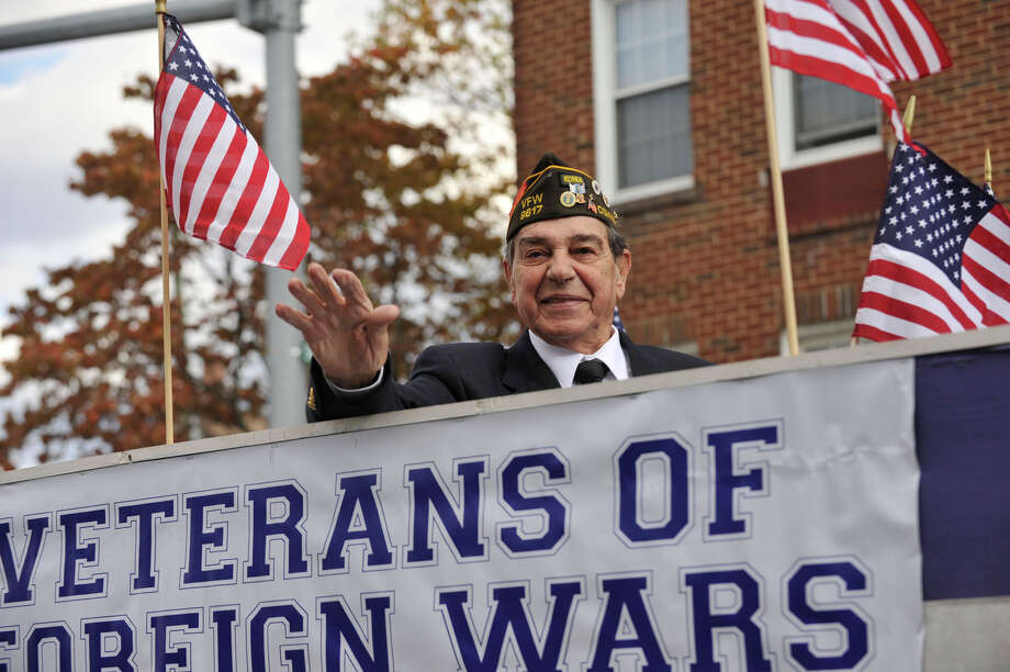 The Veterans Day parade took place in downtown Stamford, Conn., on Sunday, Nov. 10, 2013. Photo: Jason Rearick / Stamford Advocate