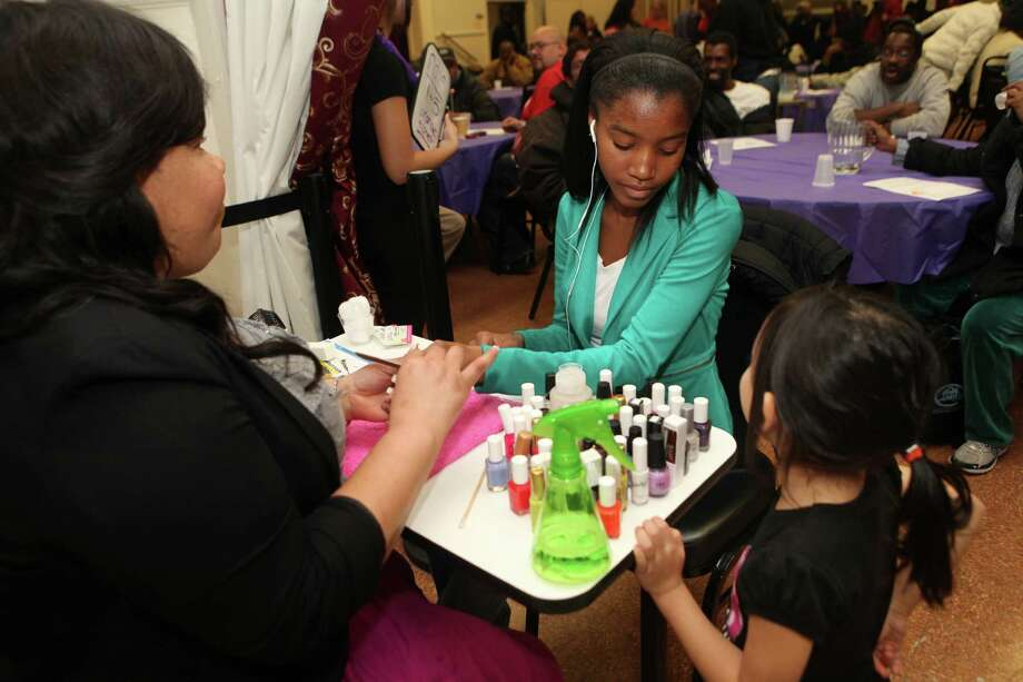 Keisha Morris, of La Petite Nails and More, paints the nails of Clinaya Williams, 15, of Bridgeport, at the 2013 Community Outreach Beauty Event sponsored by Empowering Through Beauty, Inc. on Sunday, Nov. 10, 2013 at the Norma F. Pfriem Urban Outreach Initiatives in Bridgeport. Photo: BK Angeletti, B.K. Angeletti / Connecticut Post freelance B.K. Angeletti