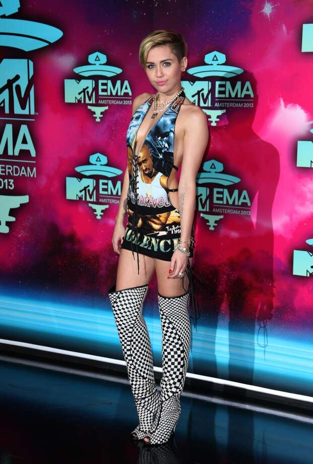 Miley Cyrus poses for photographers upon arrival at the 2013 MTV Europe Music Awards, in Amsterdam, Netherlands, Sunday, Nov. 10, 2013. Photo: Joel Ryan, Joel Ryan/Invision/AP