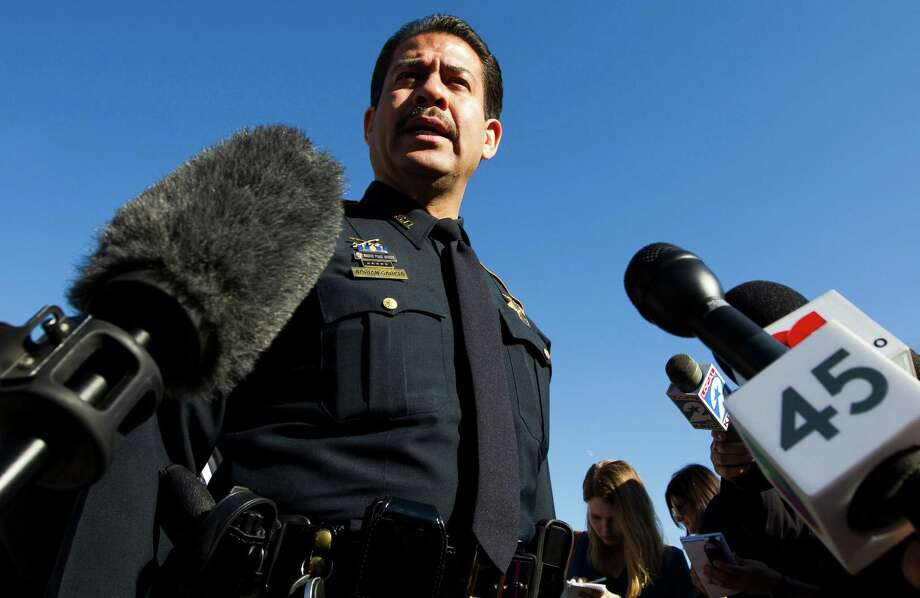 Harris County Sheriff Adrian Garcia talks to the media Sunday, Nov. 10, 2013 outside a home where two people were killed and at least 20 othersinjured late Saturday when gunfire erupted during a house party in the Cypress area. The shooting broke out about 11:15 p.m. in the 7300 block of Enchanted Creek Drive, in Houston. (AP Photo/Houston Chronicle, J. Patric Schneider) Photo: J. Patric Schneider, Associated Press / Houston Chronicle