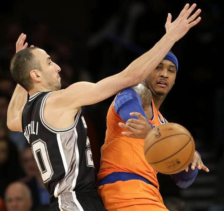 New York Knicks' Carmelo Anthony, right, passes around San Antonio Spurs' Manu Ginobili during the first half of an NBA basketball game at Madison Square Garden, Sunday, Nov. 10, 2013, in New York. (AP Photo/Seth Wenig) Photo: Seth Wenig, AP / AP