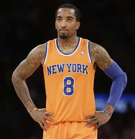 New York Knicks' J.R. Smith reacts after a Knicks foul during the first half of the NBA basketball game against the San Antonio Spurs at Madison Square Garden, Sunday, Nov. 10, 2013, in New York. (AP Photo/Seth Wenig) Photo: Seth Wenig, AP / AP