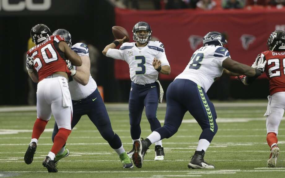1. Seattle can dominate when everything's clicking  There was nothing different about the personnel on the field Sunday in Atlanta -- in fact, Seattle started a theoretically weaker offensive line than the past two weeks without the leadership of center Max Unger (concussion). Even without their starting tackles, Russell Okung and Breno Giacomini, Seattle and its backups on the O-line gave Wilson plenty of time to sit in the pocket and find his receivers. Unlike most of the season, No. 3 had to scramble away from pressure only a handful of times Sunday.  With just one regular starter on the line -- J.R. Sweezy at right guard -- the Seahawks also opened up big running lanes for Marshawn Lynch, who put together his most dominant game of the year. And once Seattle established its running game, the team looked unstoppable on offense -- something Seahawks fans have grown accustomed to missing this season. Head coach Pete Carroll and his staff evidently did a yeoman's job preparing the O-line for Atlanta's mediocre pass-rush, and backups Paul McQuistan (left tackle), James Carpenter (left guard), Lemuel Jeanpierre (center) and Michael Bowie (right tackle) performed masterfully.  Seattle struck first with a first-quarter field goal by Steven Hauschka, then stuck a fork in the Falcons with 20 points in the second quarter. By halftime, the Seahawks had a 23-3 lead; just like Seattle did last January in the divisional playoffs, Atlanta faced a 20-point deficit at the break Sunday. But the Falcons aren't good enough to engineer a Wilson-esque comeback, and proved it again Sunday by remaining stagnant throughout the second half of the contest. Seattle, meanwhile, continued to dominate on both sides of the ball. Photo: John Bazemore, Associated Press