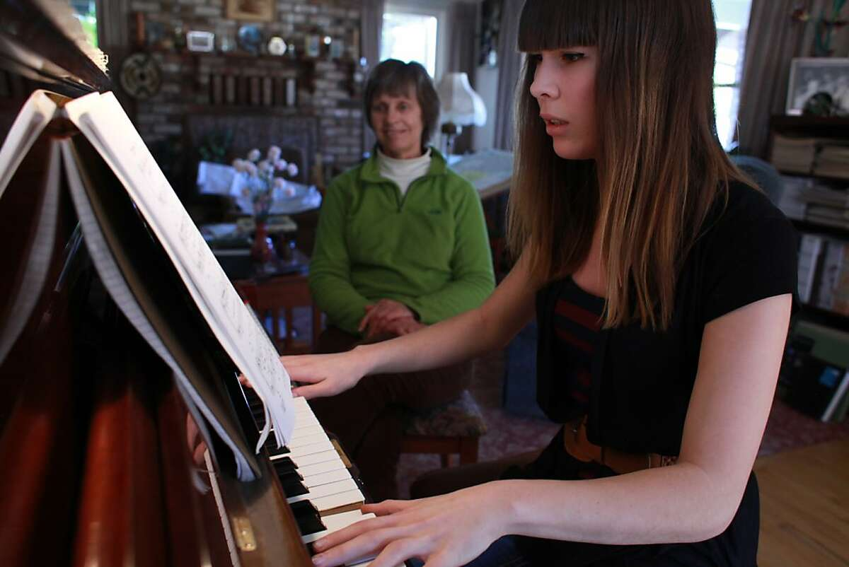 {transgender14} Eli Erlick, 17, a transgender teen durring her piano leason with her teacher Jenny Watts on Wednesday March 13th 2013. Watts has been Erlick's teacher for both classical and jazz piano for the past ten years. By SAM WOLSON/SPECIAL TO THE CHRONICLE