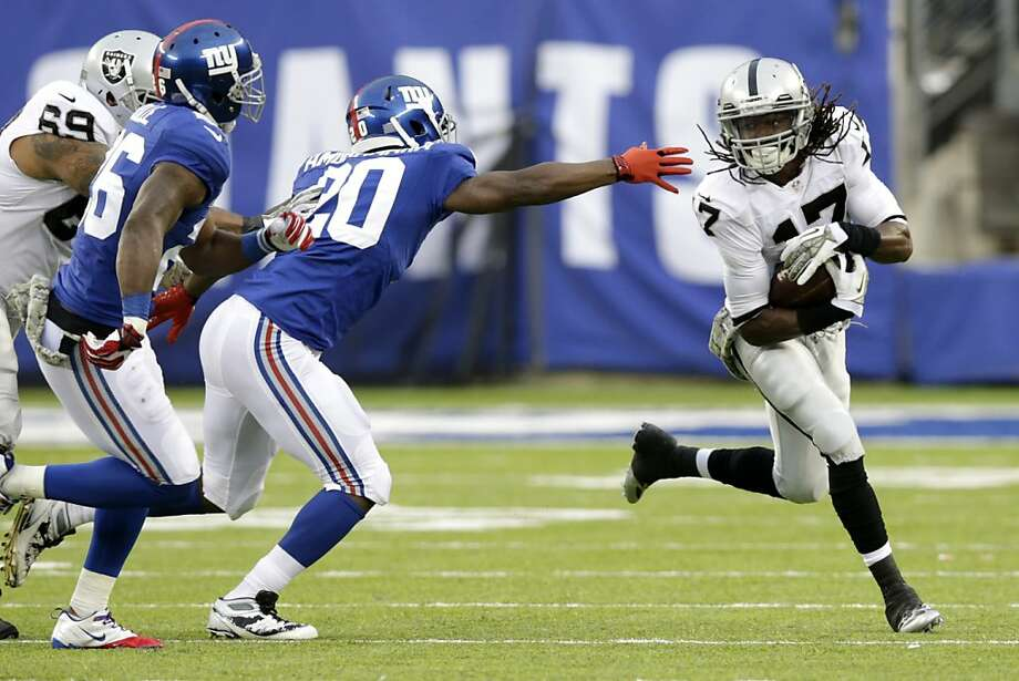 Oakland Raiders wide receiver Denarius Moore (17) runs with the ball as New York Giants cornerback Prince Amukamara (20) reaches out during the second half of an NFL football game, Sunday, Nov. 10, 2013, in East Rutherford, N.J. The Giants won 24-20. (AP Photo/Kathy Willens) Photo: Kathy Willens, Associated Press