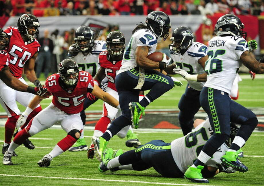 Great: Seattle's patchwork offensive line  The O-line has been a consistent goat this season, giving up numerous sacks and giving Lynch no room to run in most of Seattle's contests this year. But on Sunday, against the Falcons' 21st-ranked run defense, the Hawks racked up 211 yards on the ground and gave up just one sack. Meanwhile, Wilson had the time to throw for 287 yards through the air.  The offensive line -- comprising backups Paul McQuistan, James Carpenter, Lemuel Jeanpierre, Michael Bowie and starter J.R. Sweezy -- also helped seal the game. The Falcons had only three possessions in the second half because the O-line and a rushing combination of Lynch, Robert Turbin and Christine Michael ran 18:41 off the clock in the second half. Photo: Scott Cunningham, Getty Images / 2013 Getty Images