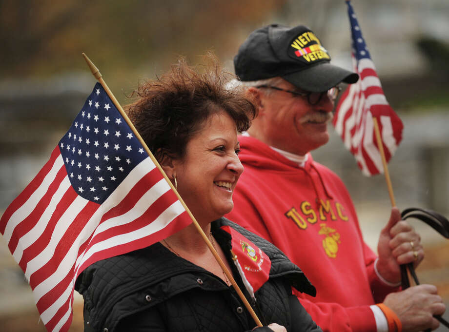 Michele Loso and Vietnam vet Jim Broatch watch the Veteran's Day Parade in downtown Milford, Conn. on Sunday, November 10, 2013. Photo: Brian A. Pounds / Connecticut Post