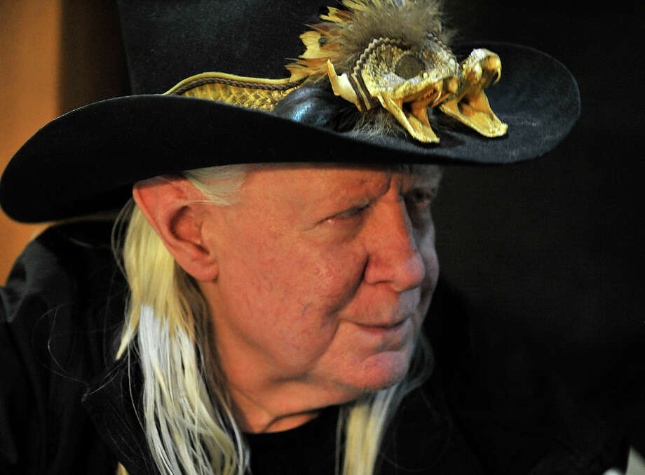 Blues guitarist Johnny Winter signs autographs in his tour bus outside Johnny's, a record store in Darien, Conn., before performing in Fairfield later that night on Sunday, Nov. 10, 2013. Photo: Jason Rearick / Stamford Advocate