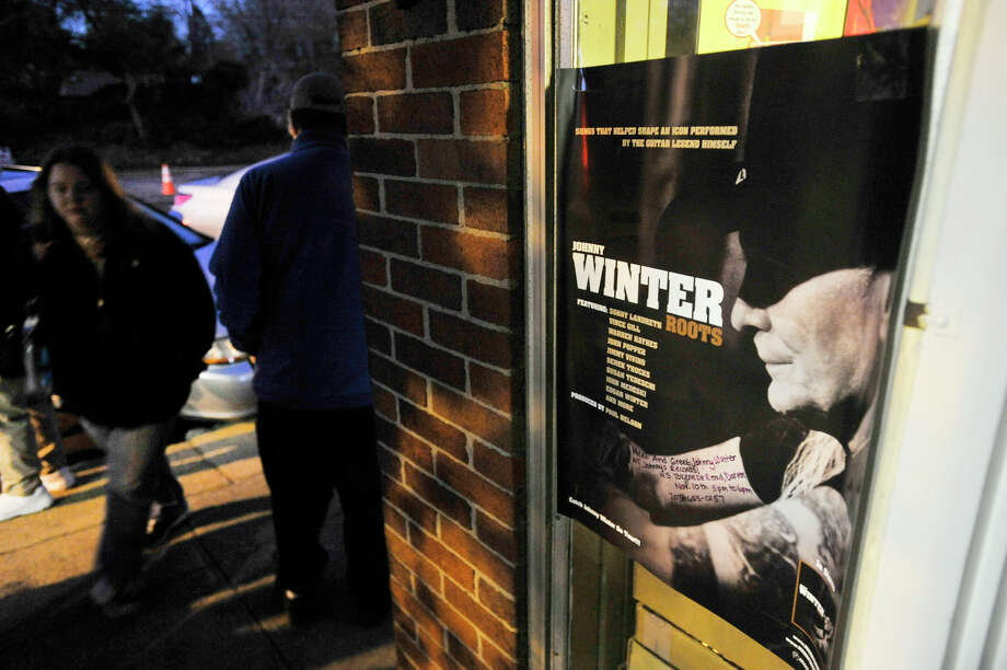 Fans of blues guitarist Johnny Winter wait for the musician to arrive outside Johnny's, a record store in Darien, Conn., on Sunday, Nov. 10, 2013. Photo: Jason Rearick / Stamford Advocate