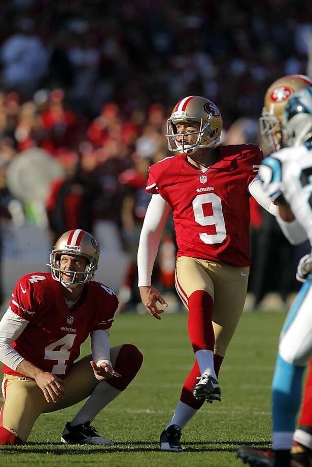 Phil Dawson watches his third field goal against Carolina. He kicked four  Sunday against Seattle. Photo: Carlos Avila Gonzalez, The Chronicle