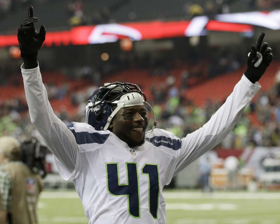 Seattle Seahawks cornerback Byron Maxwell (41) celebrates a Seattle Seahawks victory over the Atlanta Falcons 33-10 after the second half of an NFL football game, Sunday, Nov. 10, 2013, in Atlanta. (AP Photo/John Bazemore) Photo: AP