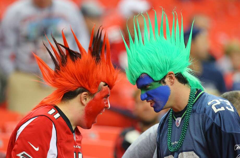 An Atlanta Falcons fan and a Seattle Seahawks fan face-off during the second half of a NFL football game on Sunday, Nov. 10, 2013, in Atlanta. (AP Photo/Atlanta Journal-Constitution, Curtis Compton)  MARIETTA DAILY OUT; GWINNETT DAILY POST OUT; LOCAL TV OUT; WXIA-TV OUT; WGCL-TV OUT Photo: AP