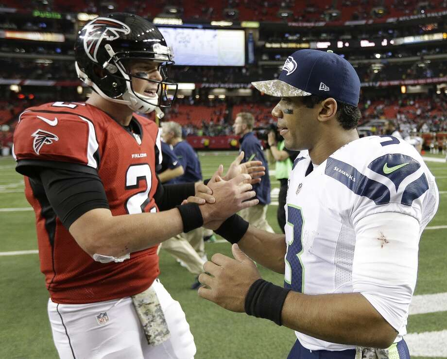 Atlanta Falcons quarterback Matt Ryan (2) speaks with Seattle Seahawks quarterback Russell Wilson (3) after the second half of an NFL football game, Sunday, Nov. 10, 2013, in Atlanta. The Seattle Seahawks won 33-10. (AP Photo/David Goldman) Photo: ASSOCIATED PRESS