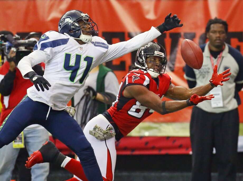 Atlanta Falcons wide receiver Roddy White attempts a catch in the endz one with Seattle Seahawks' Byron Maxwell defending during the second half of a NFL football game on Sunday, Nov. 10, 2013, in Atlanta. (AP Photo/Atlanta Journal-Constitution, Curtis Compton)  MARIETTA DAILY OUT; GWINNETT DAILY POST OUT; LOCAL TV OUT; WXIA-TV OUT; WGCL-TV OUT Photo: AP