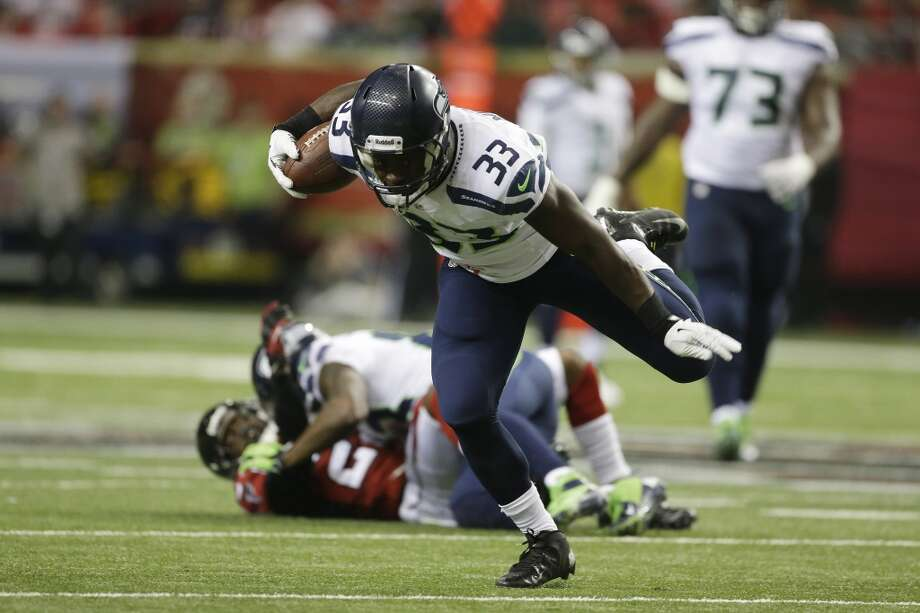 Seattle Seahawks running back Christine Michael (33) runs against the Atlanta Falcons during the second half of an NFL football game, Sunday, Nov. 10, 2013, in Atlanta. (AP Photo/John Bazemore) Photo: AP
