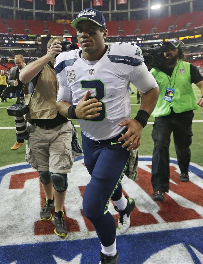 Seattle Seahawks quarterback Russell Wilson (3) runs off the field after the second half of an NFL football game against the Atlanta Falcons, Sunday, Nov. 10, 2013, in Atlanta. The Seattle Seahawks won 33-10. (AP Photo/John Bazemore) Photo: AP
