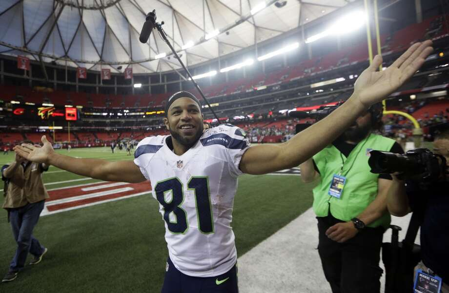 Seattle Seahawks wide receiver Golden Tate (81) celebrates after the second half of an NFL football game against the Atlanta Falcons, Sunday, Nov. 10, 2013, in Atlanta. Seattle Seahawks won 33-10. (AP Photo/John Bazemore) Photo: AP