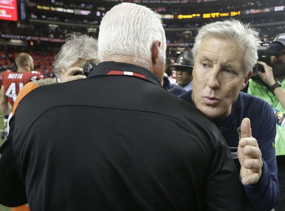 Seattle Seahawks head coach Pete Carroll, right speaks with Atlanta Falcons head coach Mike Smith during the second half of an NFL football game, Sunday, Nov. 10, 2013, in Atlanta. Seattle Seahawks won 33-10. (AP Photo/John Bazemore) Photo: AP