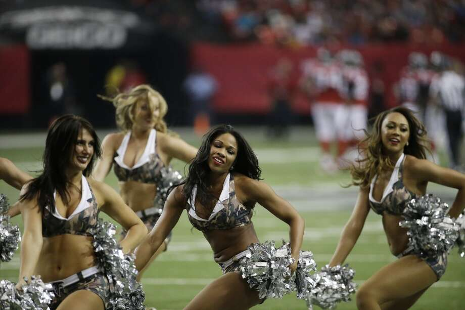 Atlanta Falcons cheerleaders wearing Digital Camouflage for the Salute Service moment during the second half of an NFL football game against the Seattle Seahawks, Sunday, Nov. 10, 2013, in Atlanta. (AP Photo/John Bazemore) Photo: AP