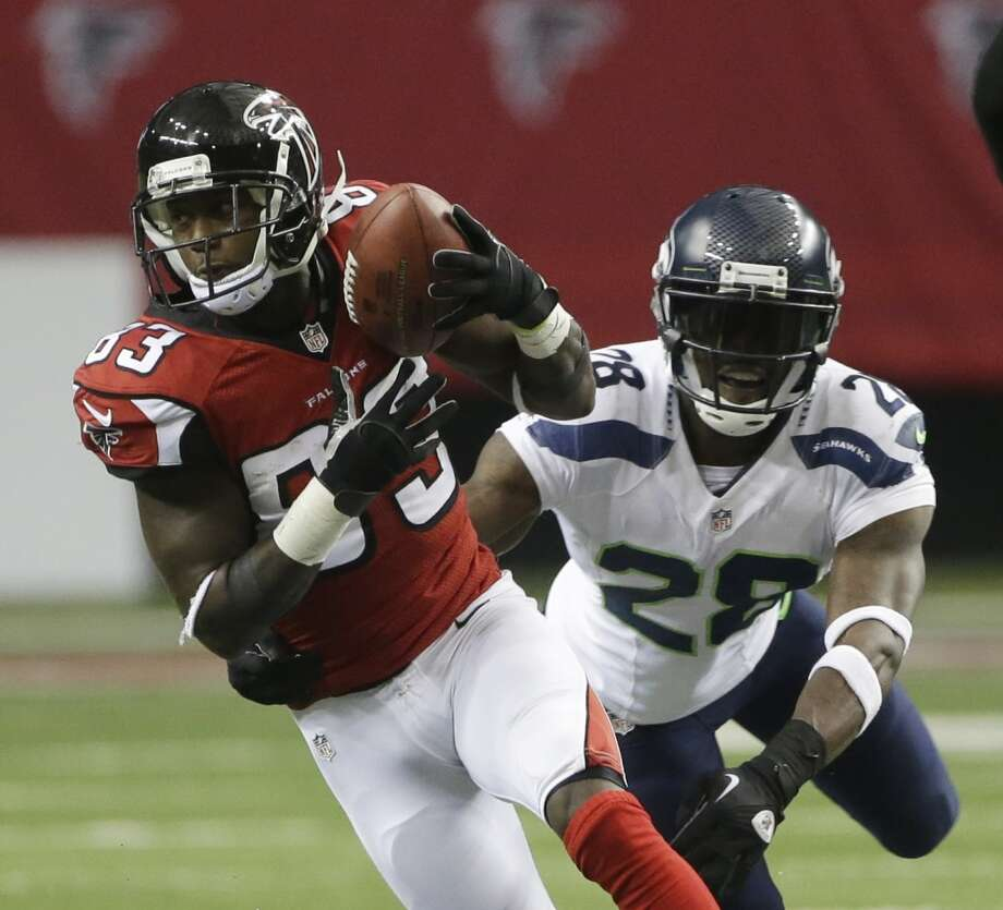 Atlanta Falcons wide receiver Harry Douglas (83) makes the catch against Seattle Seahawks cornerback Walter Thurmond (28) during the second half of an NFL football game, Sunday, Nov. 10, 2013, in Atlanta. (AP Photo/John Bazemore) Photo: ASSOCIATED PRESS