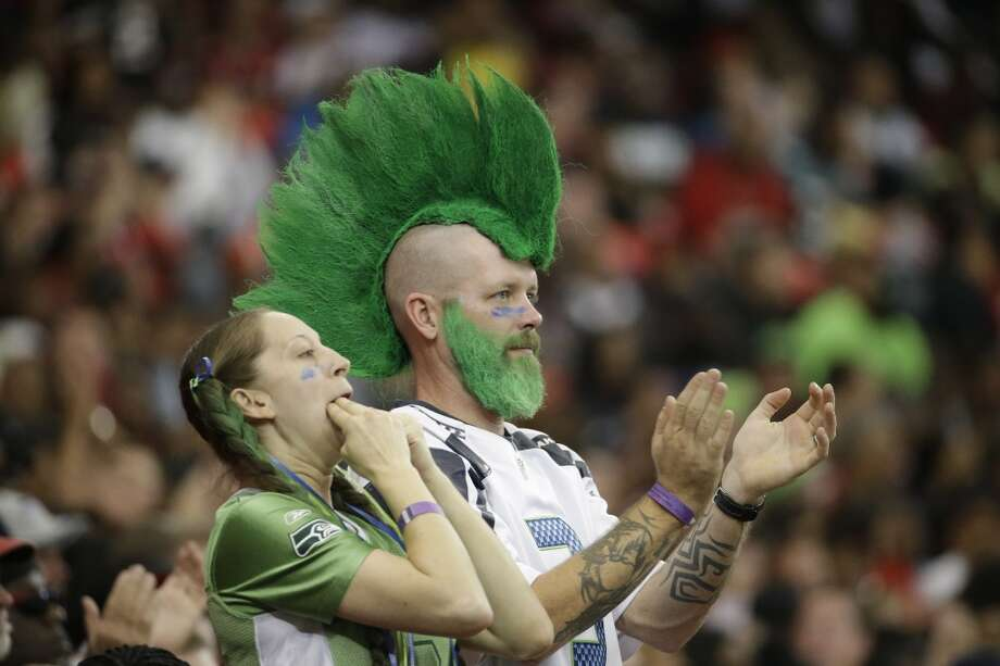 Seattle Seahawks fans cheer against the Atlanta Falcons during the second half of an NFL football game, Sunday, Nov. 10, 2013, in Atlanta. (AP Photo/David Goldman) Photo: AP