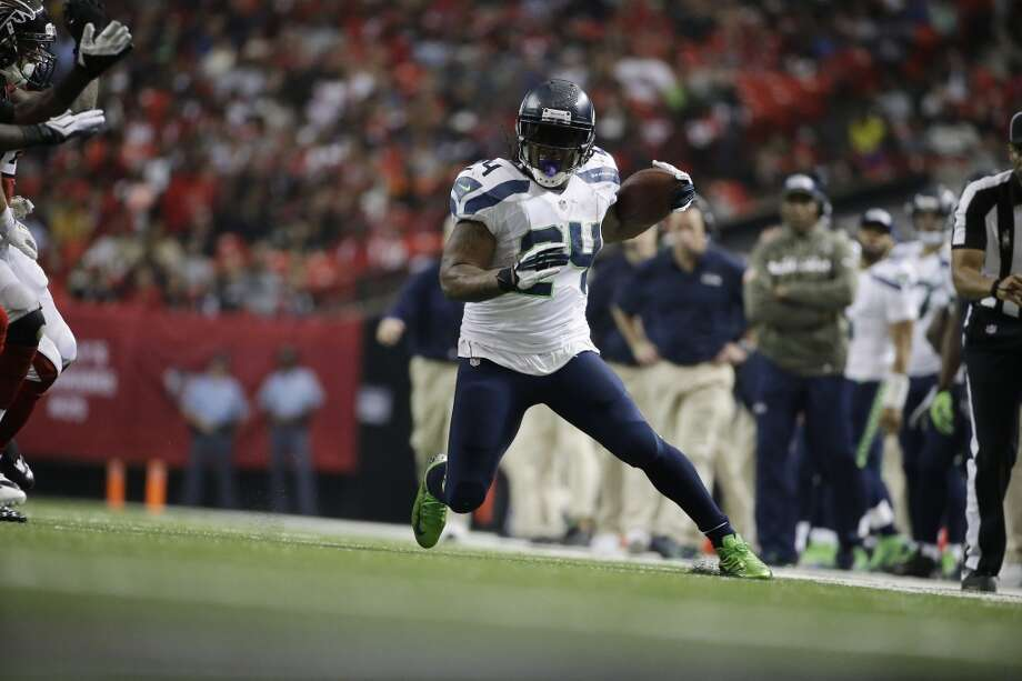 Seattle Seahawks running back Marshawn Lynch (24) works against the Atlanta Falcons during the second half of an NFL football game, Sunday, Nov. 10, 2013, in Atlanta. (AP Photo/David Goldman) Photo: AP
