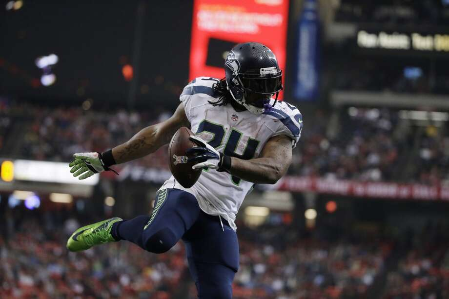 Seattle Seahawks running back Marshawn Lynch (24) scores a touchdown against Atlanta Falcons free safety Thomas DeCoud (28)during the second half of an NFL football game, Sunday, Nov. 10, 2013, in Atlanta. (AP Photo/David Goldman) Photo: AP