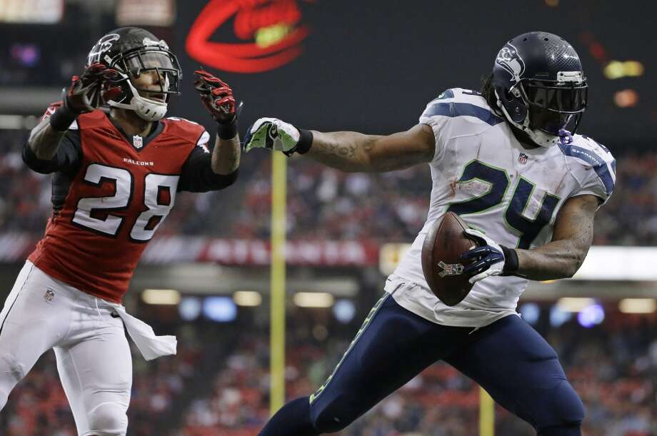 Seattle Seahawks running back Marshawn Lynch (24) scores a touchdown against Atlanta Falcons free safety Thomas DeCoud (28)during the second half of an NFL football game, Sunday, Nov. 10, 2013, in Atlanta. (AP Photo/David Goldman) Photo: ASSOCIATED PRESS