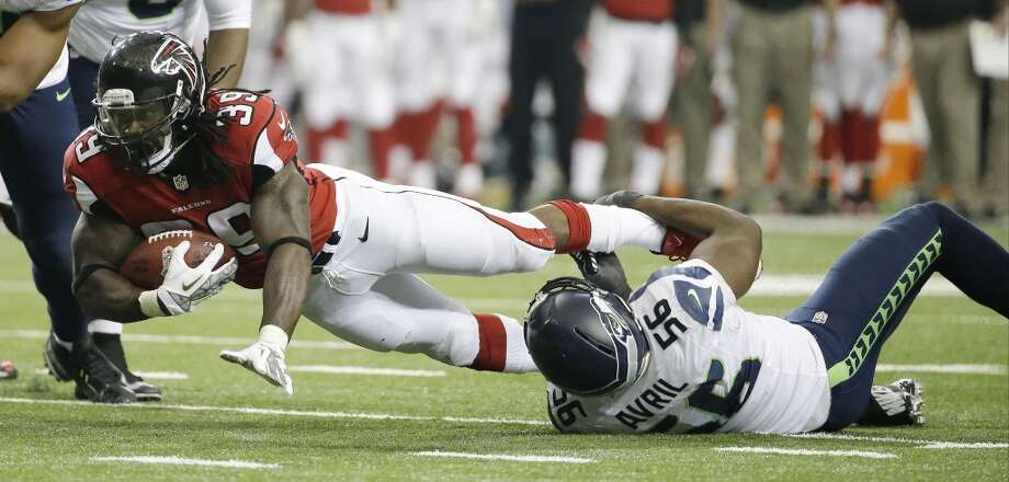 Atlanta Falcons running back Steven Jackson (39) is talked by Seattle Seahawks defensive end Cliff Avril (56) during the second half of an NFL football game, Sunday, Nov. 10, 2013, in Atlanta. (AP Photo/David Goldman) Photo: AP