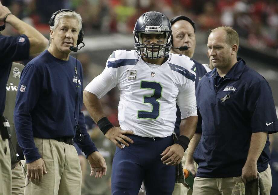 Seattle Seahawks quarterback Russell Wilson (3) and Seattle Seahawks head coach Pete Carroll, left, watch officials during the first half of an NFL football game, Sunday, Nov. 10, 2013, in Atlanta. (AP Photo/David Goldman) Photo: AP