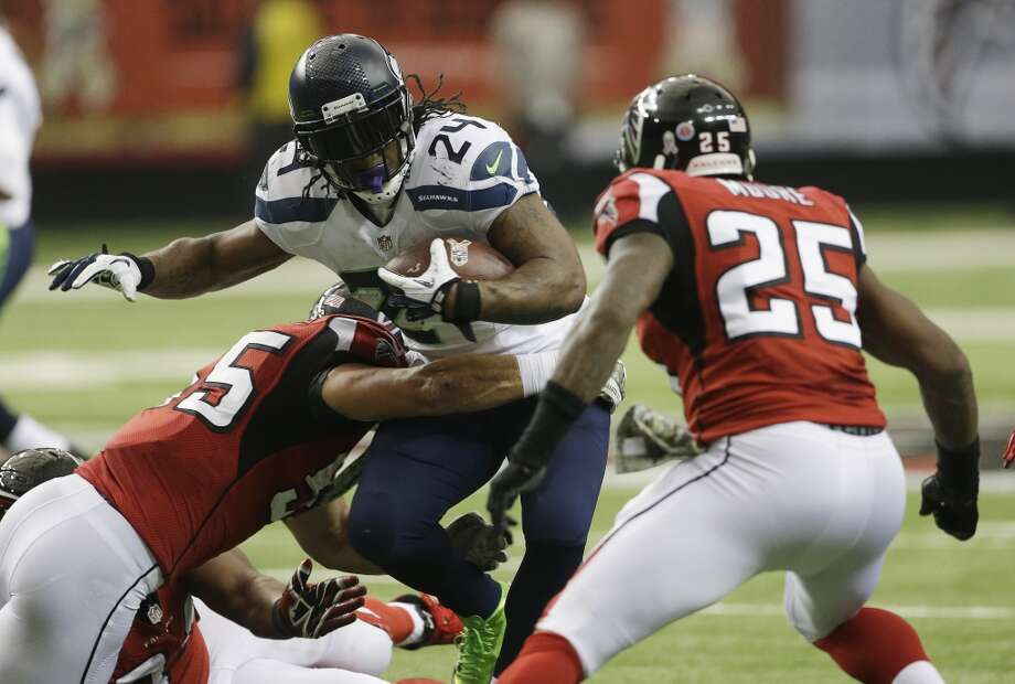 Seattle Seahawks running back Marshawn Lynch (24) moves against Atlanta Falcons strong safety William Moore (25) during the first half of an NFL football game, Sunday, Nov. 10, 2013, in Atlanta. (AP Photo/John Bazemore) Photo: AP